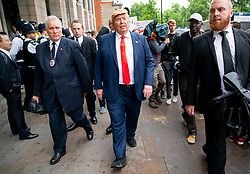 © Licensed to London News Pictures. 04/06/2019. London, UK. A man dressed as the President of the United States of America Donald Trump walks through Westminster, whilst Trump was in Downing Street having a meeting with British Prime Minister Theresa May as part of a state visit to the UK. Photo credit : Tom Nicholson/LNP