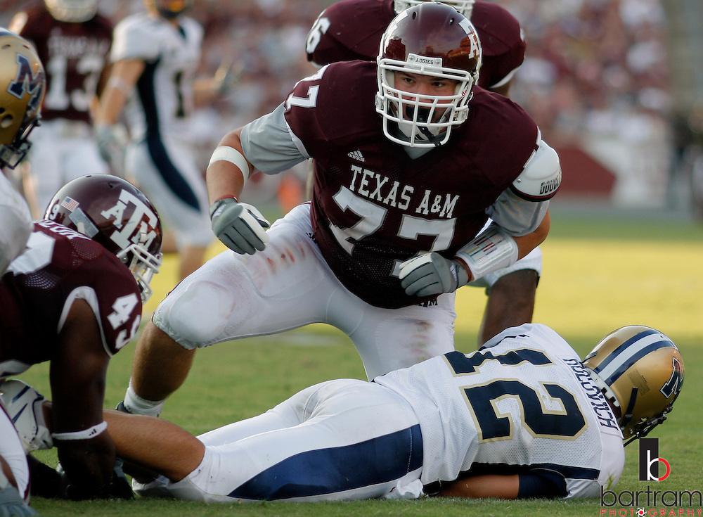 Texas A&M defensive lineman Lucas Patterson looks up after sacking Montana State quarterback Jack Rolovich during the third quarter at Kyle Field in College Station, TX. Texas A&M won the game 38-7.