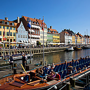 Nyhavn is a colorful 17th century waterfront, canal and popular entertainment district in Copenhagen, Denmark. It is lined by brightly coloured 17th and early 18th century townhouses and numerous bars, cafés and restaurants.