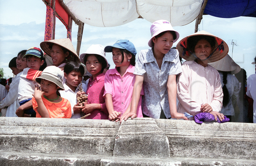 A group of vietnamese people assist to a catholic procession in Nam Dinh province, Vietnam, Asia