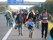 Migrants walk along the motorway towards Budapest after they  broke out from the camp close to the Hungarian and Serbian border town of Roszke, Hungary, September 7 2015. The UN's humanitarian agencies are on the verge of bankruptcy and unable to meet the basic needs of millions of people because of the size of the refugee crisis in the Middle East, Africa and Europe, senior figures within the UN have told the media.