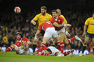 Mike Phillips of Wales passes the ball. Dove Men, autumn international test, Wales v Australia at the Millennium Stadium in Cardiff on Sat 1st Dec 2012. pic by Andrew Orchard, Andrew Orchard sports photography,