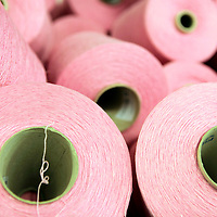 Europe, Ireland, Avoca. Spools of pink wool threads at Avoca Handweavers Mill, County Wicklow.