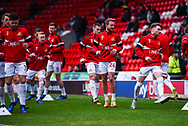 Doncaster players including James Coppinger of Doncaster Rovers (26) warming up during the The FA Cup fourth round match between Doncaster Rovers and Oldham Athletic at the Keepmoat Stadium, Doncaster, England on 26 January 2019.