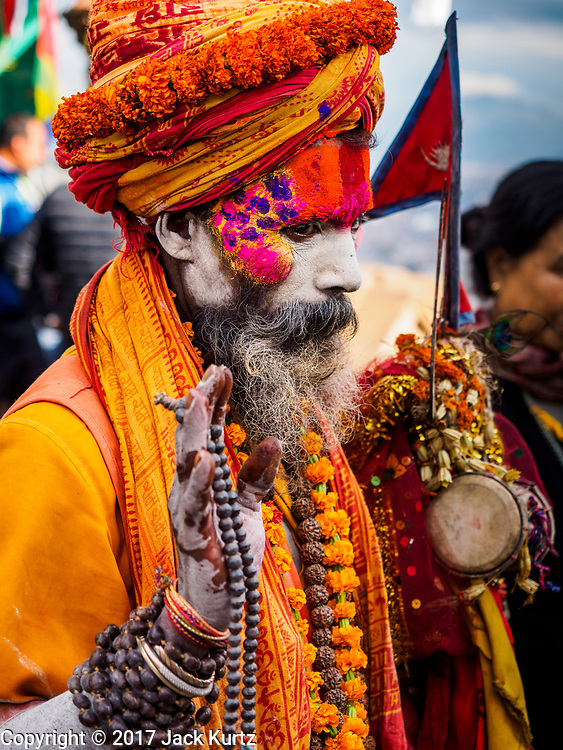 11 MARCH 2017 - KATHMANDU, NEPAL:  A Hindu sadhu (holy man) at Swayambhu Stupa. The second most important Buddhist stupa in Kathmandu, Swayambhu Stupa is also a historic landmark and has panoramic views of Kathmandu. It is sacred to both Buddhists and Hindus. The stupa is being rebuilt because it was badly damaged in the 2015 earthquake.   PHOTO BY JACK KURTZ