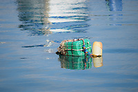 Green 5 gallon container used as a buoy