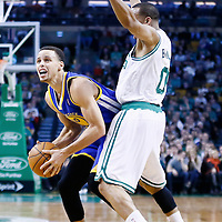 01 March 2013: Golden State Warriors point guard Stephen Curry (30) is fouled by Boston Celtics point guard Avery Bradley (0) during the Boston Celtics 94-86 victory over the Golden State Warriors at the TD Garden, Boston, Massachusetts, USA.