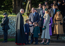 The Duke and Duchess of Cambridge with Prince George and Princess Charlotte as they speak to Reverend Canon Jonathon Riviere after attending the Christmas Day morning church service at St Mary Magdalene Church in Sandringham, Norfolk.