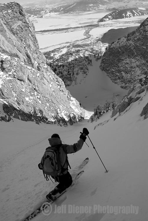 A young man skis the Sliver Couloir on Nez Perce Peak, Grand Teton National Park, Jackson Hole, Wyoming.