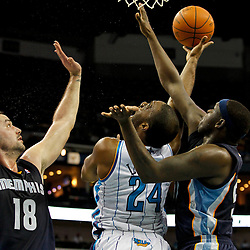 December 21, 2011; New Orleans, LA, USA; New Orleans Hornets power forward Carl Landry (24) shoots over Memphis Grizzlies small forward Josh Davis (18) and power forward Zach Randolph (50) during the second quarter of a game at the New Orleans Arena.   Mandatory Credit: Derick E. Hingle-US PRESSWIRE