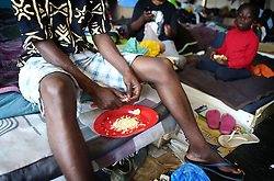 South Africa - Cape Town - 06 October 2020 - Refugee man cutting garlic as he prepares food at the refugee settlement at Paint City Bellville where they have been housed for the duration of the lockdown. The group of refugees from various countries in Africa has been protesting for a year, asking the UNHCR for assistance to leave South Africa because they fear for there safety and the safety of their families. Picture: Brendan Magaar/African News Agency(ANA)