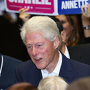 Former President Bill Clinton poses with supporters after speaking in support of Florida Democratic gubernatorial candidate Charlie Crist and running mate Annette Taddeo during a campaign event on Monday, Nov. 3, 2014, at the UCF Arena in Orlando, Fla. Crist, a former Florida Republican governor, is running against Republican Florida Gov. Rick Scott.  (AP Photo/Alex Menendez)