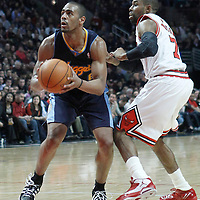 26 March 2012: Denver Nuggets shooting guard Arron Afflalo (6) eyes the basket past Chicago Bulls point guard C.J. Watson (7) during the Denver Nuggets 108-91 victory over the Chicago Bulls at the United Center, Chicago, Illinois, USA. NOTE TO USER: User expressly acknowledges and agrees that, by downloading and or using this photograph, User is consenting to the terms and conditions of the Getty Images License Agreement. Mandatory Credit: 2012 NBAE (Photo by Chris Elise/NBAE via Getty Images)