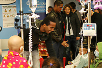 """Atletico de Madrid's players Paulo Assuncao, Cleber Santana and Diego Forlan  during a visit to the Children's Hospital """"La Paz"""" in Madrid. January 04 2010..(ALTERPHOTOS/Acero)."""