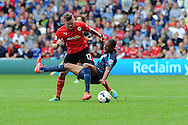 Newcastle's Moussa Sissoko is tackled by Cardiff's Aron Gunnarsson. Barclays Premier League match, Cardiff city v Newcastle Utd  at the Cardiff city stadium in Cardiff, South Wales on Saturday 5th Oct 2013. pic by Andrew Orchard, Andrew Orchard sports photography,