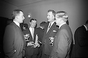 Sterling Moss is the guest of honour at a midnight matinee showing of films from the Irish Shell and BP Library at the Savoy Cinema. The event was organised by the Motor Enthusiasts Group in aid of The Irish Society for the Prevention of Cruelty to Children..08.02.1966.<br /> Robin Rhodes, Peter Jenkins, ?? Jimmy Cleary,