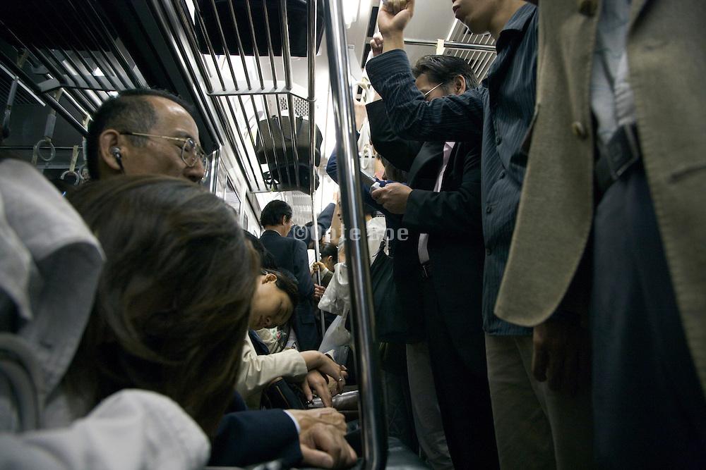 a Tokyo subway train during rush hour