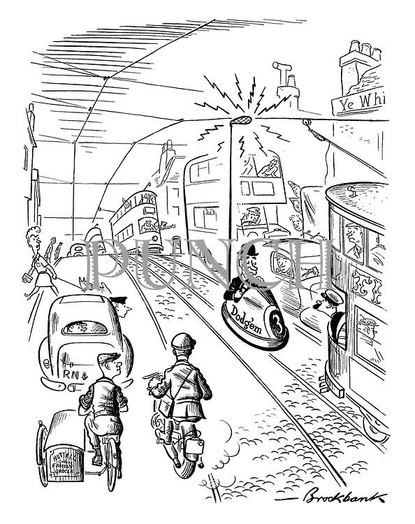(A man driving a dodgem car down the tram tracks)