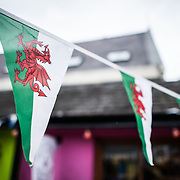 A string of Welsh flags on a pennant in Beaumaris on the island of Anglesey of the north coast of Wales, UK.