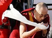 His Holiness the Dalai Lama of Tibet offers a white scarf, called a khata, as he is greeted by tory Senator Con di Nino, co-chairman of the Parliamentary Friends of Tibet, as he arrives at the Ottawa airport on Sunday Oct 28, 2007. The offering of a khata is a traditional Tibetan greeting and symbolizes purity of intention..THE CANADIAN PRESS..