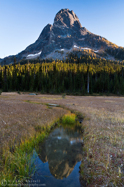 Liberty Bell Mountain is reflected in the small streams in the meadows at Washington Pass during sunset - in the North Cascades of the Okanogan-Wenatchee National Forest in Washington State, USA.