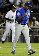 CHICAGO - JUNE 20:  Carlos Marmol #49 of the Chicago Cubs reacts after recording the final out of the game against the Chicago White Sox on June 20, 2011 at U.S. Cellular Field in Chicago, Illinois.  The Cubs defeated the White Sox 6-3.  (Photo by Ron Vesely)  Subject:  Carlos Marmol