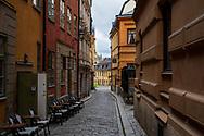 Stockholm, Sweden -- July 16, 2019. A photo shot down a winding side street in Stockholm.
