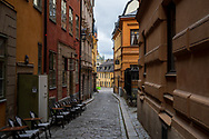 Stockholm, Sweden -- July 16, 2019. A photo shot down a winding side street in Stockholm.