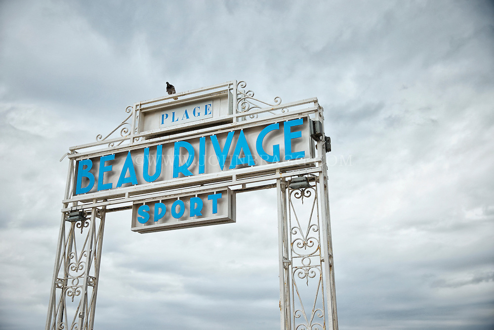 View of the Plage Beau Rivage Sport Hotel and Restaurant sign found along the Promenade des Anglais, Nice, France.