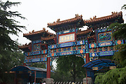 "The south gate of the Yonghe Temple, also known as the ""Palace of Peace and Harmony Lama Temple"", the ""Yonghe Lamasery"", or - popularly - the ""Lama Temple"" is a temple and monastery of the Geluk School of Tibetan Buddhism located in the northeastern part of Beijing, China. It is one of the largest and most important Tibetan Buddhist monasteries in the world. The building and the artworks of the temple is a combination of Han Chinese and Tibetan styles."