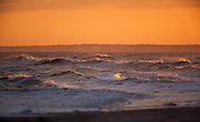 Orange Sky with waves at sunset