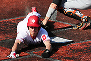 BLOOMINGTON, IN - MARCH 10, 2018 - Outfielder Logan Kaletha #11 of the Indiana Hoosiers sides into home plate during the game against University of the Pacific Tigers and the Indiana Hoosiers at Bart Kaufman Field in Bloomington, IN. Photo By Craig Bisacre/Indiana Athletics