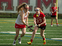 Laconia's Becca Howe and Campbell's Autumn Thompson go after a loose ball during NHIAA division III girls lacrosse Wednesday afternoon.  (Karen Bobotas/for the Laconia Daily Sun)