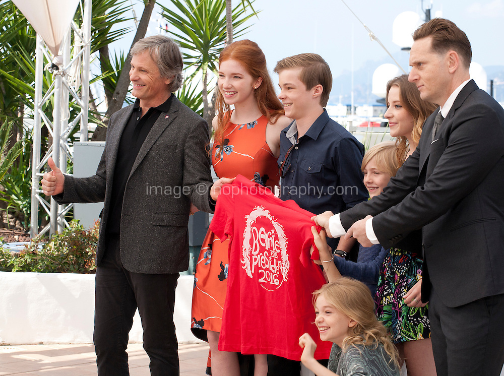 Actor Viggo Mortensen, actress Annalise Basso, actor Nicholas Hamilton,  actor Charlie Shotwell, actress Samantha Isler, actress Shree Crooks and director Matt Ross with a Bernie For President t-shirt at the Captain Fantastic film photo call at the 69th Cannes Film Festival Tuesday 17th May 2016, Cannes, France. Photography: Doreen Kennedy