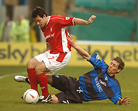 GILLINGHAM VS NOTTINGHAM FOREST<br />6TH MARCH 2004<br />GILLINGHAM'S NICKY SOUTHALL CHALLENGES ANDY REID<br /><br /><br />Picture Ady Kerry