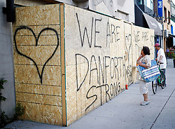 People read messages on a building under renovation, remembering the victims of a shooting on Sunday evening on Danforth, Ave. in Toronto, ON, Canada, on Monday, July 23, 2018. Photo by Mark Blinch/CP/ABACAPRESS.COM