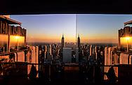New York - Manhattan cityscape ,  view from the Rainbow room  restaurant and bar in Rockfeller center. New York  Usa  /  Manhattan midtown et  l'empire state bldg vue panoramique depuis le Rainbow room  New York  USa