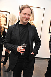 NICHOLAS KIRKWOOD at a private view of photographs by Herb Ritts held at Hamiltons Gallery, 13 Carlos Place, London on 21st June 2011.