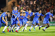 Colchester United celebrate winning on penalties during the EFL Cup match between Colchester United and Tottenham Hotspur at the JobServe Community Stadium, Colchester, England on 24 September 2019.