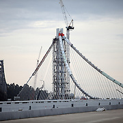 The San Francisco-Oakland Bay Bridge is under construction, and scheduled to open Labor Day 2013. The Self-Anchored Suspension Span (SAS) is the largest bridge of its kind in the world measuring 2,047 feet. This engineering and construction marvel raises the bridge building bar to new heights, as seen in these behind the scenes photos taken on Monday, March 18, 2013. This view shows the new span from the Oakland Touchdown area. (AP Photo/Alex Menendez)