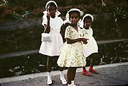 Three pretty young girls in pretty dresses for church on Easter Sunday, c 1961