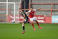 Cheltenham Town forward George Lloyd (19) challenges Crawley Town defender Josh Doherty (3) during the EFL Sky Bet League 2 match between Cheltenham Town and Crawley Town at Jonny Rocks Stadium, Cheltenham, England on 10 October 2020.