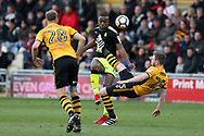 Uche Ikpeazu of Cambridge Utd  © is challenged by Mark O'Brien of Newport county (r). The Emirates FA Cup, 2nd round match, Newport County v Cambridge United at Rodney Parade in Newport, South Wales on Sunday 3rd December 2017.<br /> pic by Andrew Orchard,  Andrew Orchard sports photography.