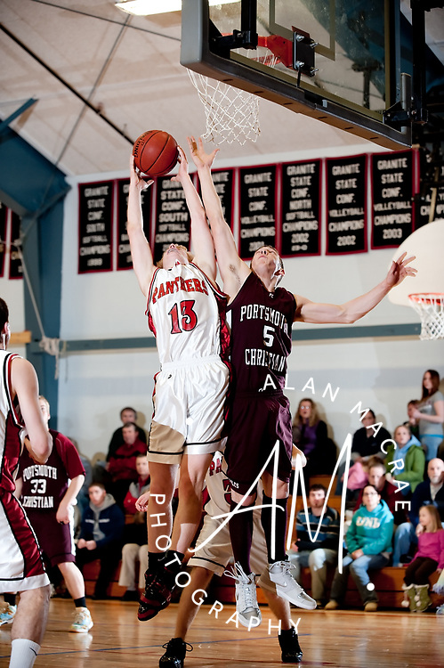 MA's Eric Moriarty grabs a rebound ahead of PCA's Kyle Pope during Monday's game at MA.  (Alan MacRae/for the Citizen)