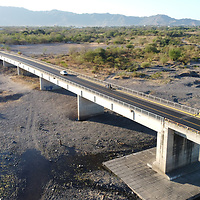 A brdige over the once-mighty river Choluteca, now nearly dry. Climate change and poor resrouce management is pushing this area of Honduras into arid conditions, and with ongoing prolonged drought, the area is in danger of becoming desert.