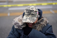 Cathy Pahsetopah, a supporter of U.S. President Donald Trump tries to stay warm outside a site for Trump's rally taking place the next day, in Des Moines, Iowa, U.S., January 29, 2020. REUTERS/Rick Wilking