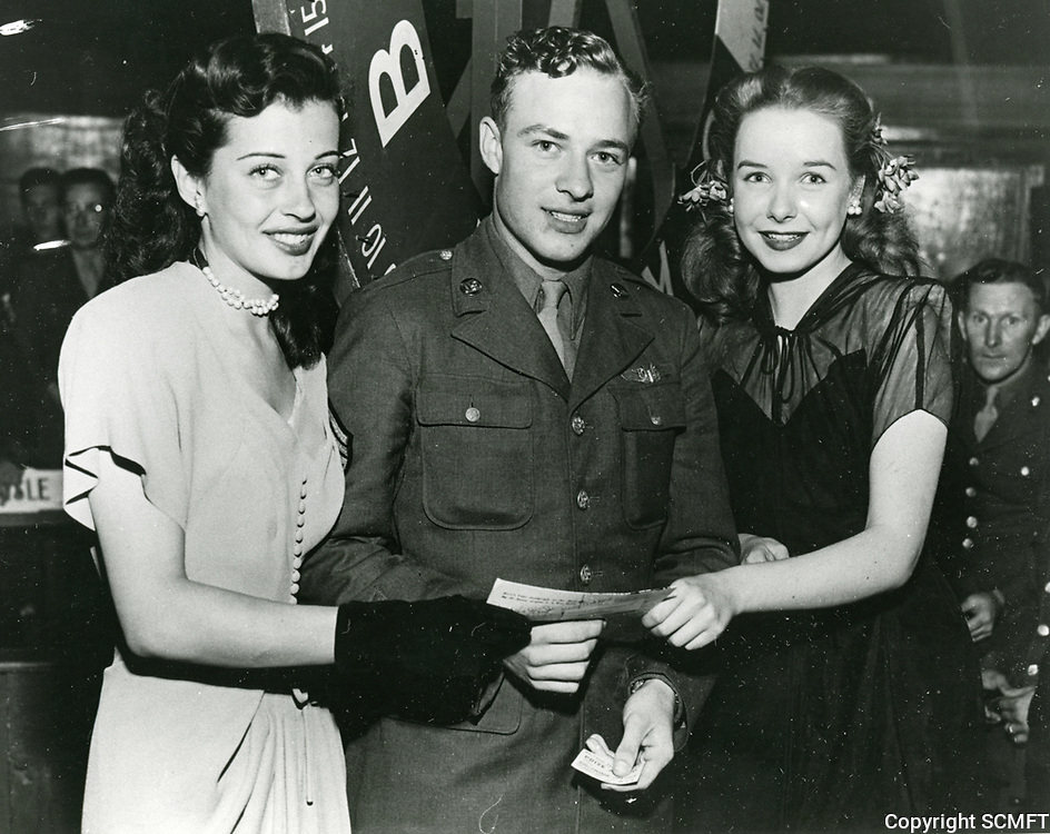 1944 Actresses, Gail Russell and Diane Lynn with a serviceman who just won a $25 war bond during a raffle at the Hollywood Canteen.