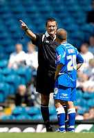 Fotball<br /> Foto: SBI/Digitalsport<br /> NORWAY ONLY<br /> <br /> Leeds United v Millwall<br /> Coca Cola Championship.<br /> 07/08/2005.<br /> <br /> Millwall's Jodie Morris (R) is given a talking to by referee G Law during repeated rapist chants from the Leeds fans.