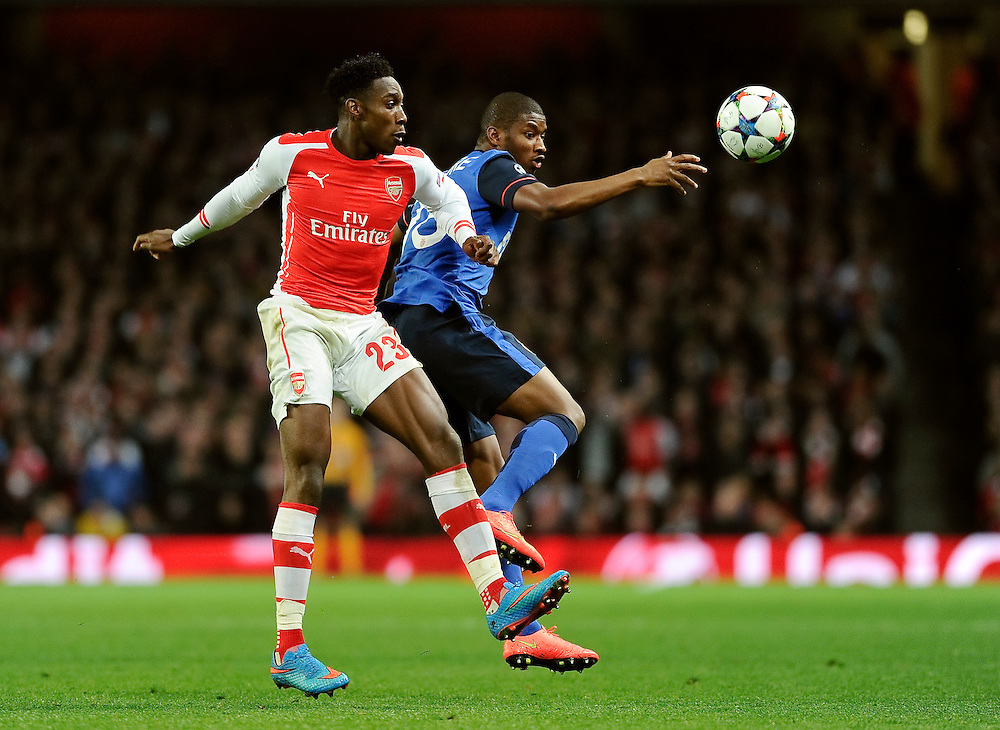 Arsenal's Danny Welbeck battles with Monaco's Almary Toure<br /> <br /> Photographer Ashley Western/CameraSport<br /> <br /> Football - UEFA Champions League Second Round 1st Leg - Arsenal v Monaco - Wednesday 25th February 2015 - Emirates Stadium - London<br /> <br /> © CameraSport - 43 Linden Ave. Countesthorpe. Leicester. England. LE8 5PG - Tel: +44 (0) 116 277 4147 - admin@camerasport.com - www.camerasport.com