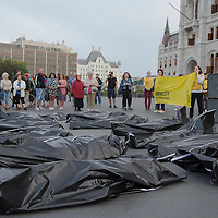Body bags lay in front of Hungarian Parliament to commemorate World Refugee Day at an event organised by Amnesty International in Budapest, Hungary on June 20, 2015. ATTILA VOLGYI